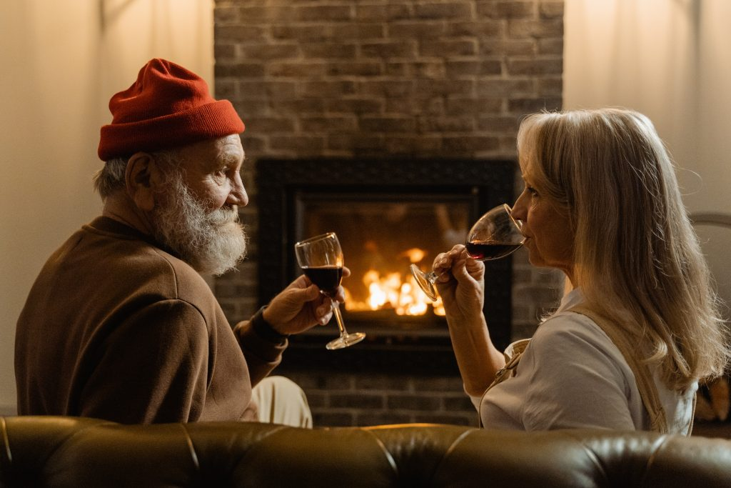 An old couple relaxing and drinking wine